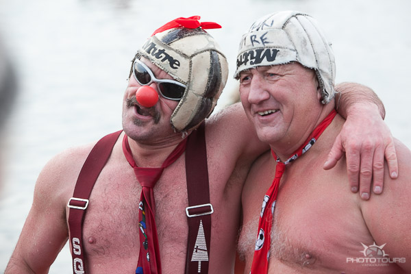 Photo Tours Vancouver two guys with rugby balls on their heads at the Polar Bear Swim by Aura McKay