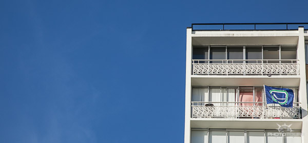 Apartment and blue sky in Vancouver by Aura McKay