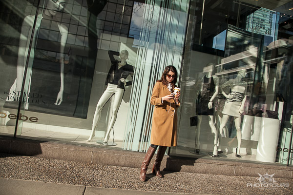 Photo Tours Vancouver woman texting on the street in front of store windows by Aura McKay