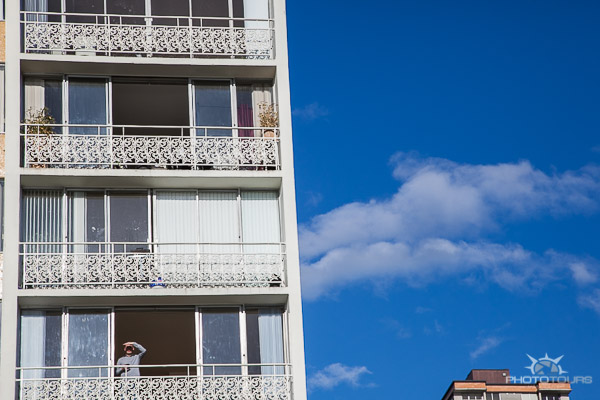Photo Tours Vancouver person on patio in highrise in English Bay by Aura McKay